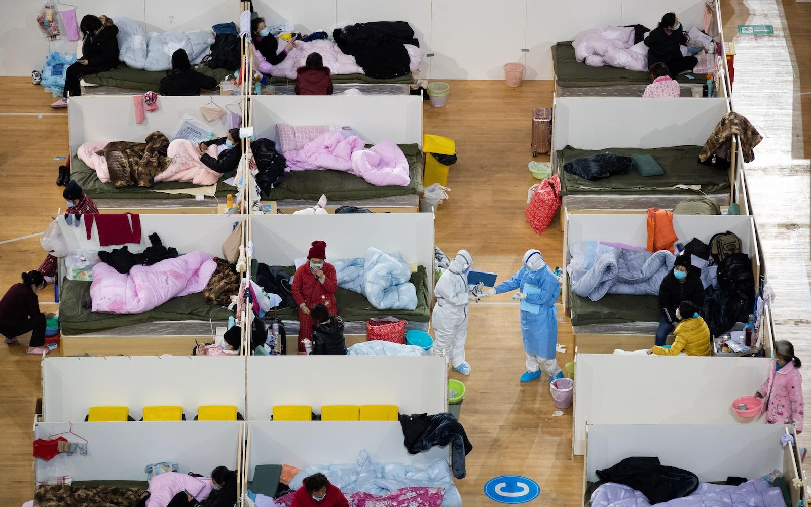 Patients with mild symptoms of the COVID-19 coronavirus in a temporary hospital at a sports stadium in Wuhan, China (STR via Getty Images)