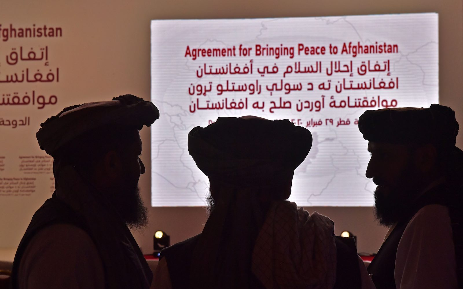 Members of the Taliban delegation attend the signing of a peace deal with the US, on 29 February 2020 in Doha, Qatar (Giuseppe Cacace/AFP via Getty Images)