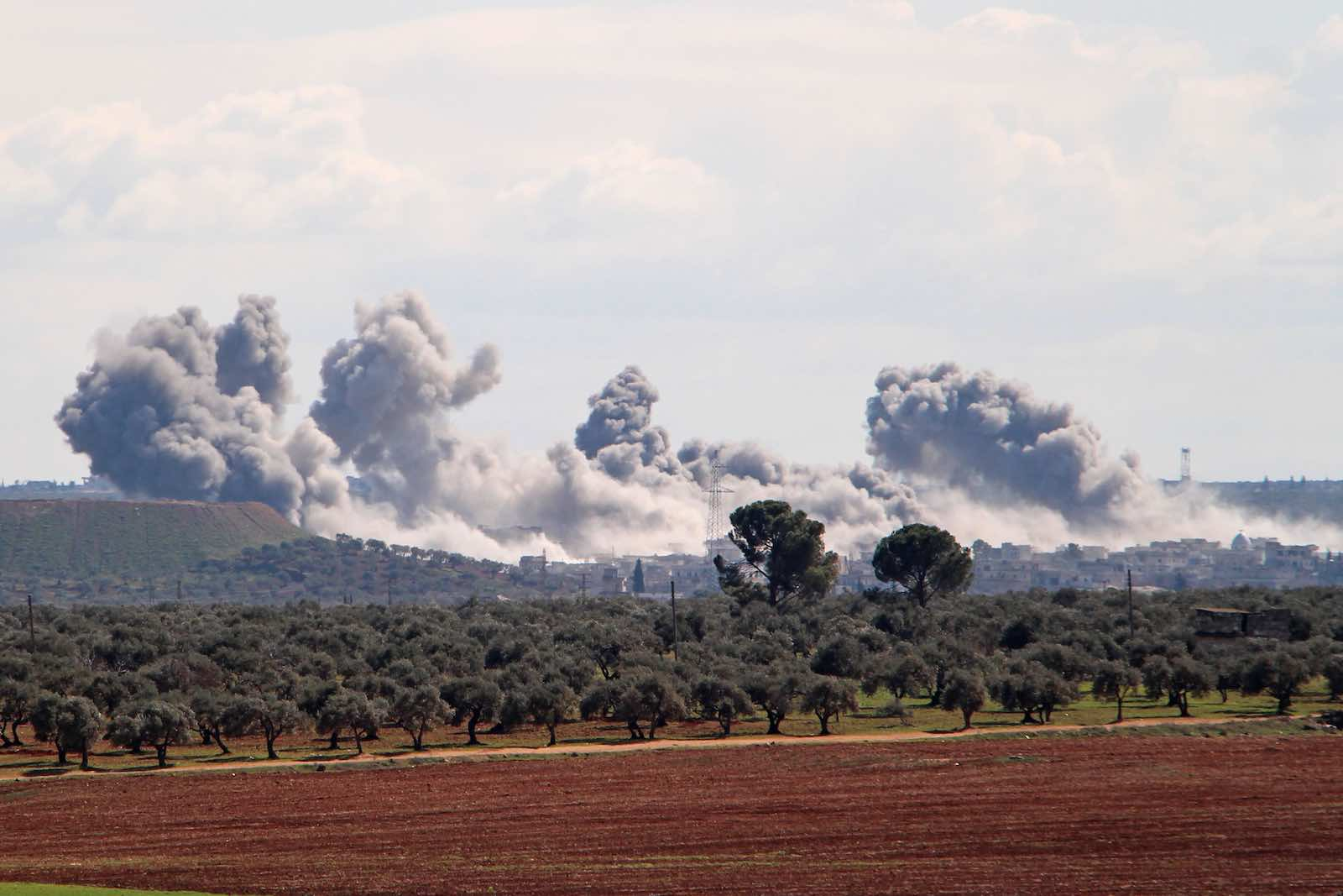 Smoke from what is reported to be Russian air strikes reported Russian air strikes in northwestern Syria on 1 March (Ibrahim Yasouf/AFP/Getty Images)