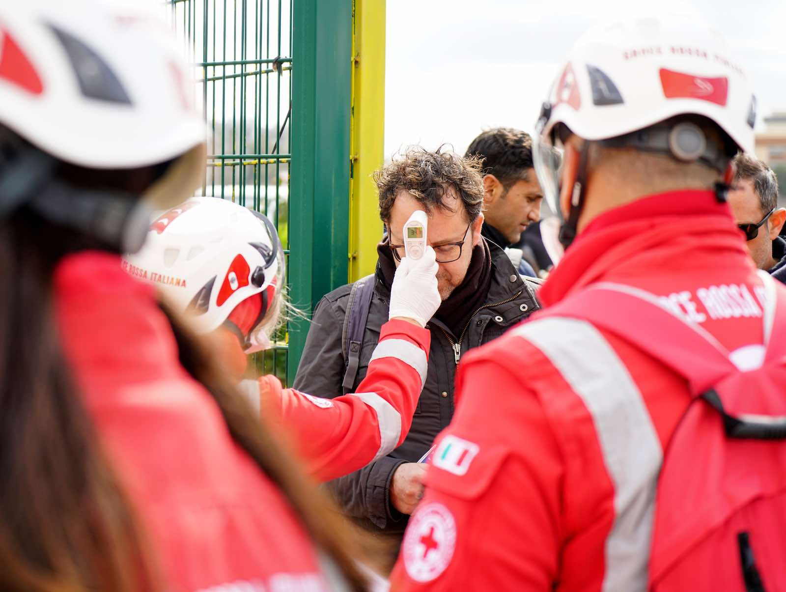 Health workers screening spectators before a soccer match in Lecce, Italy, 1 March (Gabriele Maricchiolo/NurPhoto via Getty Images)