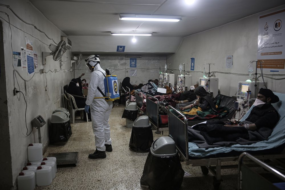 A Syrian civil defence member sprays disinfectant inside a hospital in the city of Idlib after the emergence of suspected Covid-19 cases in the province (Anas Alkharboutli/picture alliance via Getty Images)