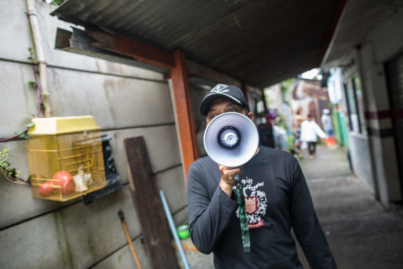Sounding the alarm – an official broadcasts social distancing regulations in Jakarta (Afriadi Hikmal/NurPhoto via Getty Images)