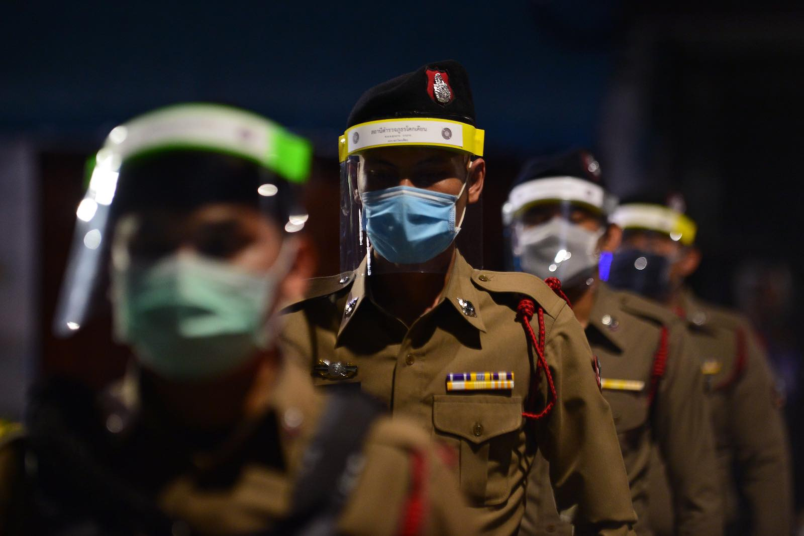 Police enforcing a nationwide night curfew in Thailand's southern province of Narathiwat aimed at stemming the spread of coronavirus (Madaree Tohlala/AFP/Getty Images)