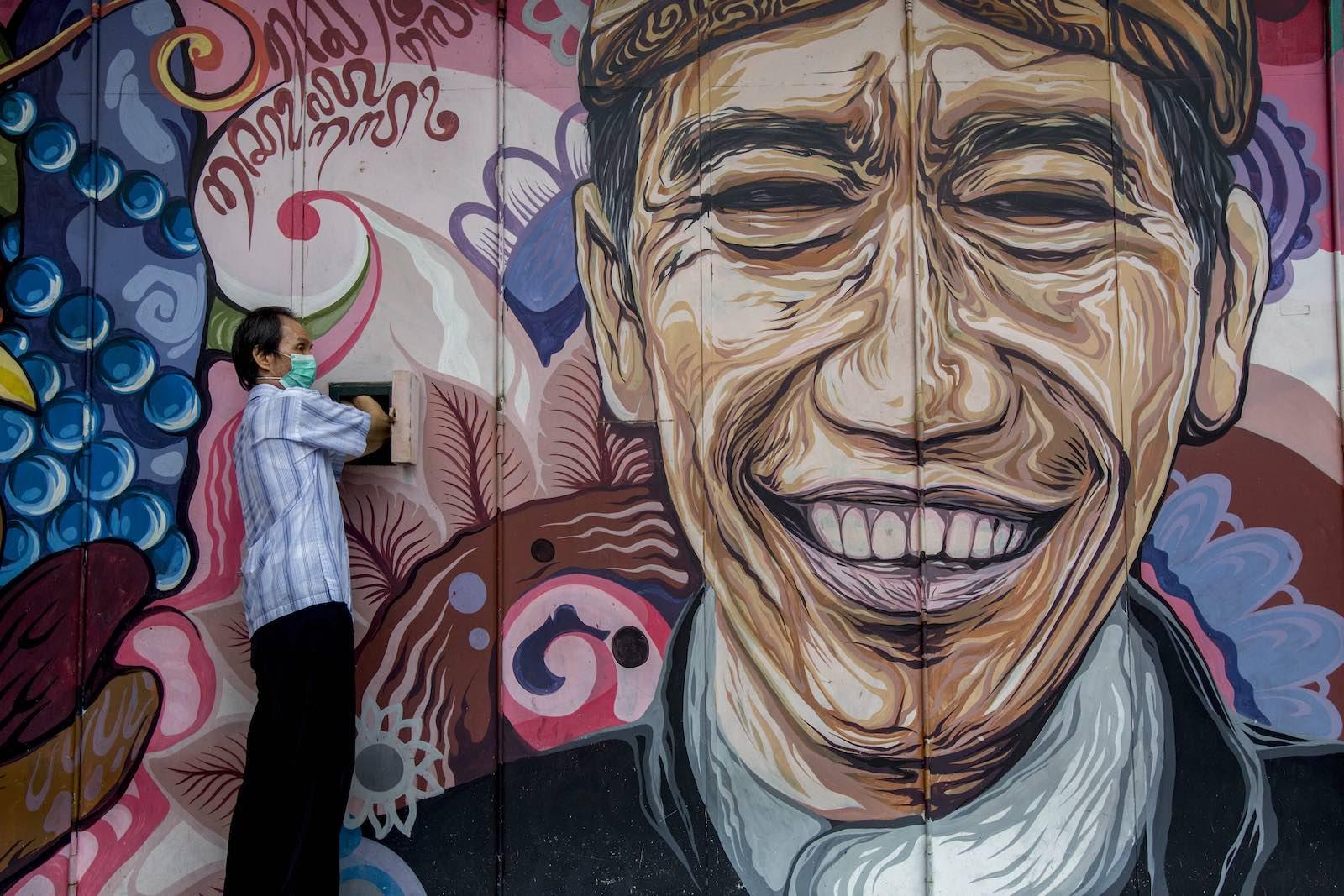 Street art depicting President Joko Widodo in Solo, Indonesia (Izzat Fahmi/Opn Images/Barcroft Media via Getty Images)