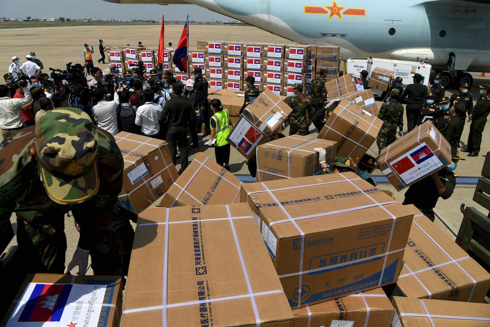 Cambodian soldiers carry aid including medical equipment from China to be used to combat the spread of the Covid-19, Phnom Penh, Cambodia (Tang Chhin Sothy/AFP via Getty Images)