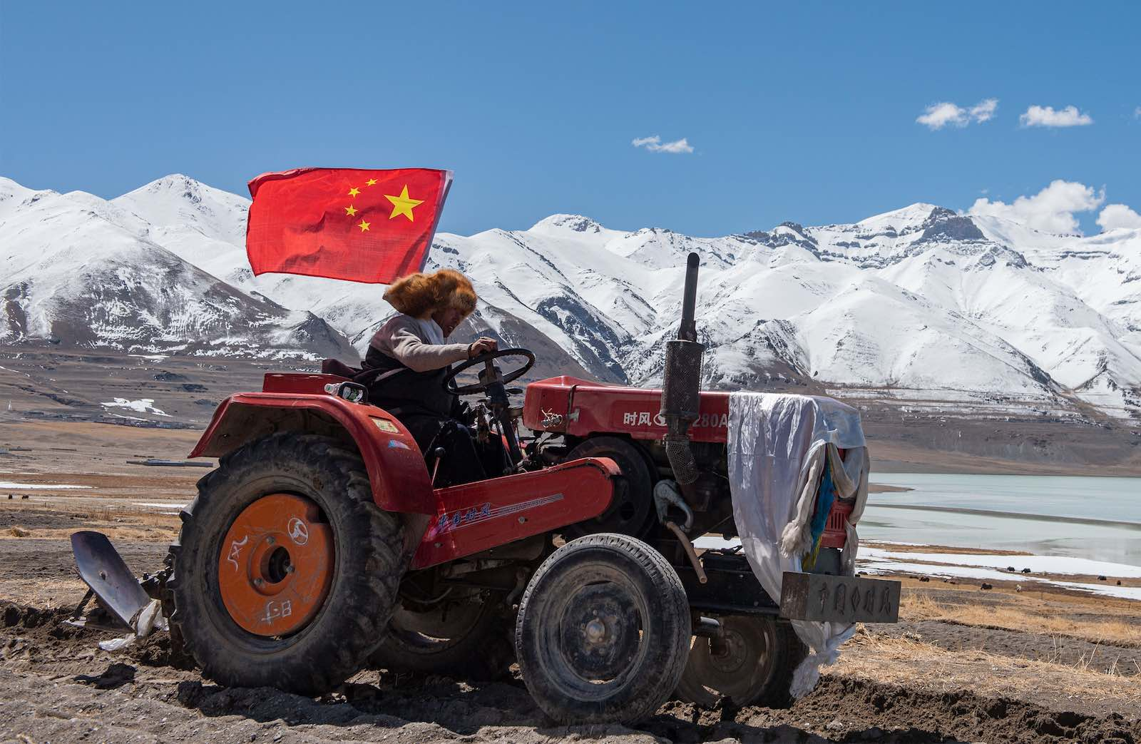 A farmer takes part in a ceremony marking the start of spring ploughing at Beicun Village in Ombu Township of Nyima County, Nagqu City, southwest China's Tibet Autonomous Region, April 2020 (Hou Jie/Xinhua via Getty Images)