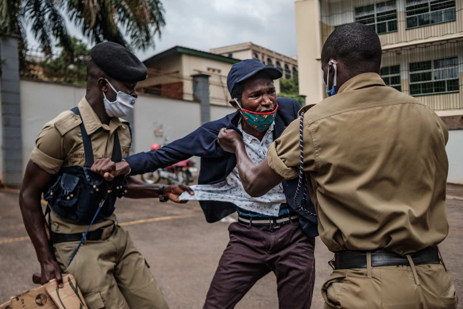 A demonstrator is arrested by police at a protest for more government food distributions during the Covid-19 crisis, 18 May in Kampala, Uganda (Sumy Sadurni/AFP via Getty Images)