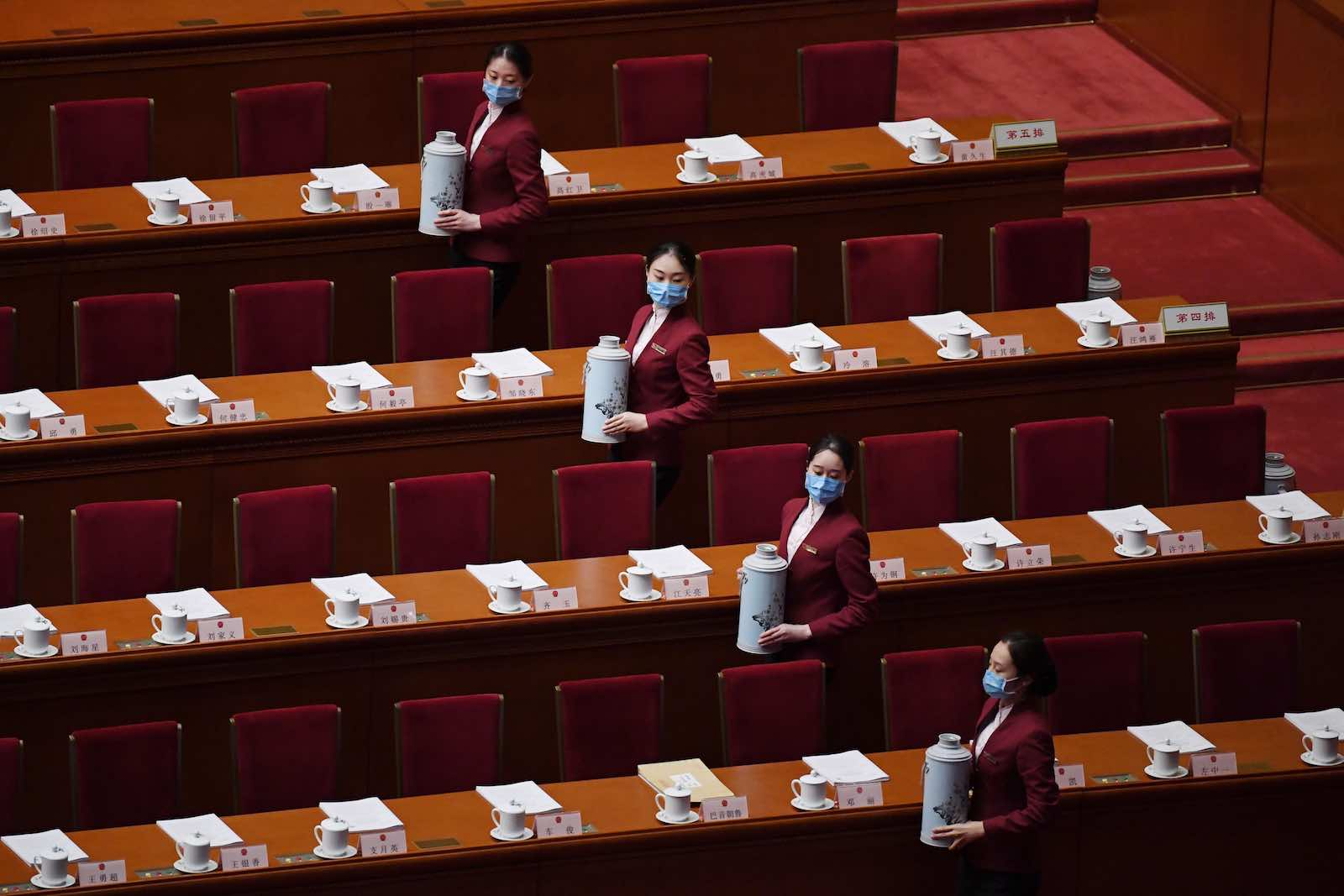 Attendants prepare to serve tea for delegates before the start of the second plenary session of the National People's Congress in the Great Hall of the People in Beijing in May (Photo by Noel Celis/AFP/Getty Images)