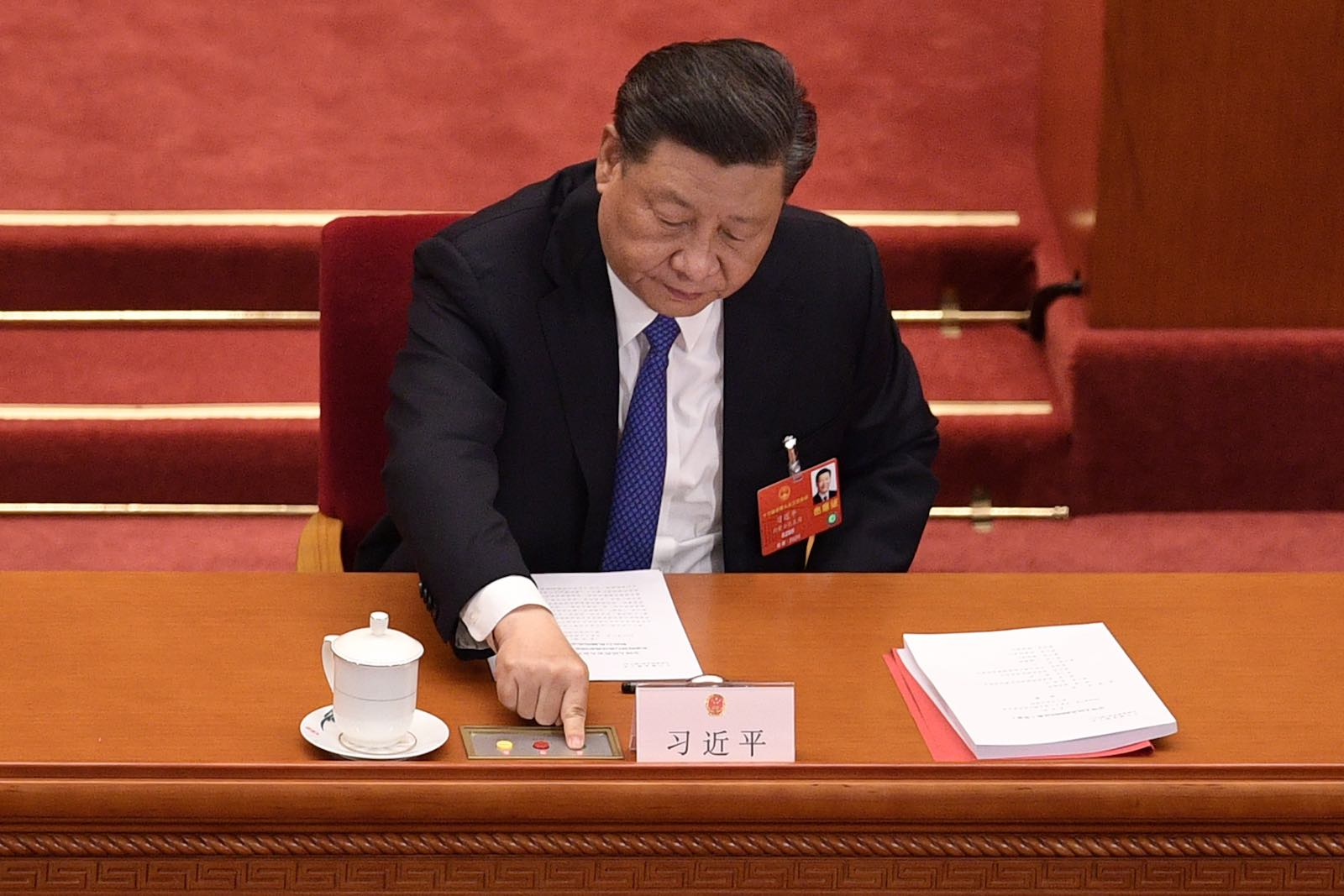 China's Xi Jinping votes on the security law for Hong Kong during the National People's Congress in Beijing in May (Nicolas Asfouri/AFP/Getty Images)