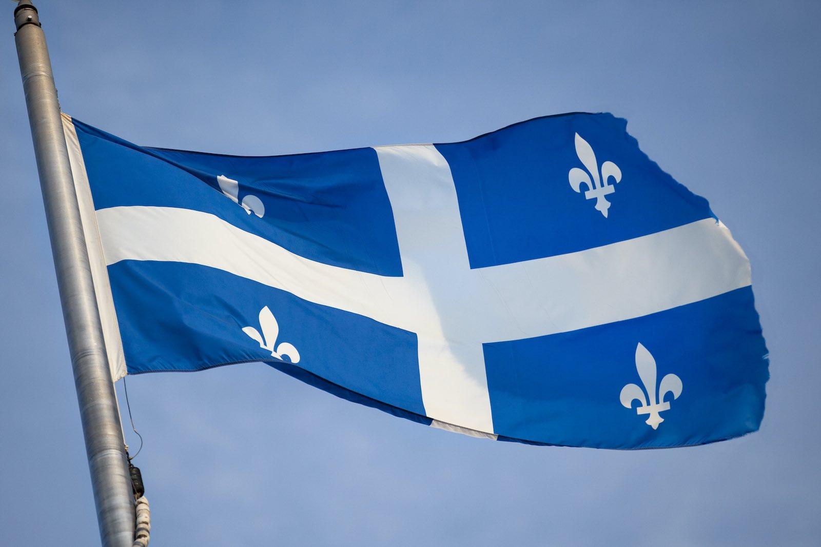 The Fleurdelisé flag of Quebec (Andrea Evangelo-Giamou/EyeEm via Getty Images)