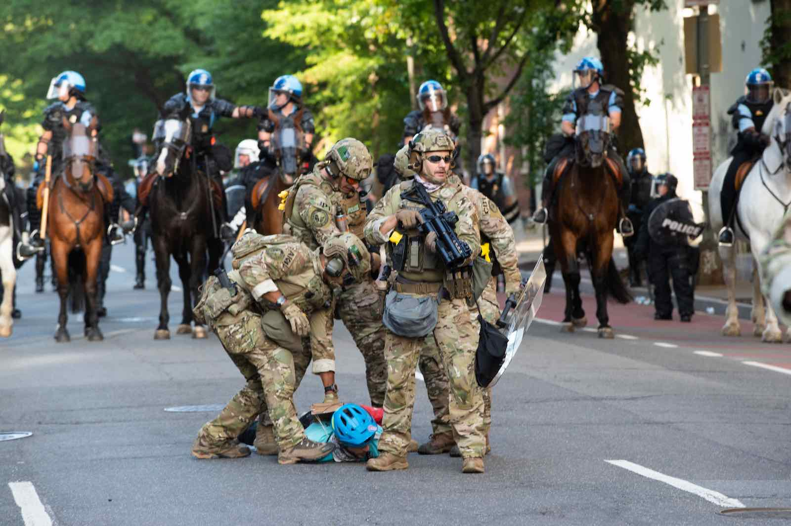 US Marshals restrain a protestor near the White House, 1 June (Roberto Schmidt/AFP via Getty Images)