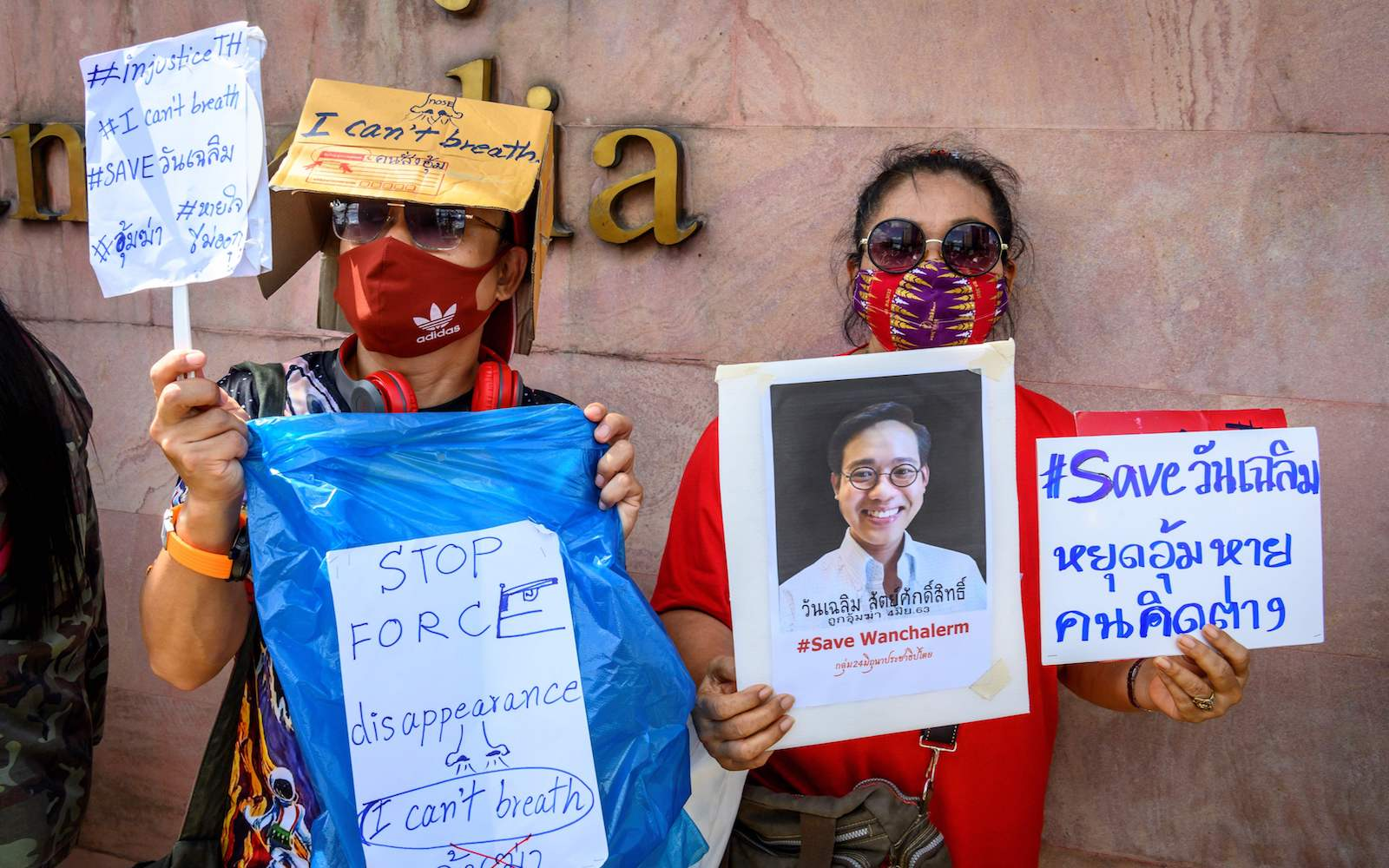 Protesters hold signs of Thai activist Wanchalearm Satsaksit outside the Cambodian embassy in Bangkok, 8 June 2020 (Mladen Antonov/AFP via Getty Images)
