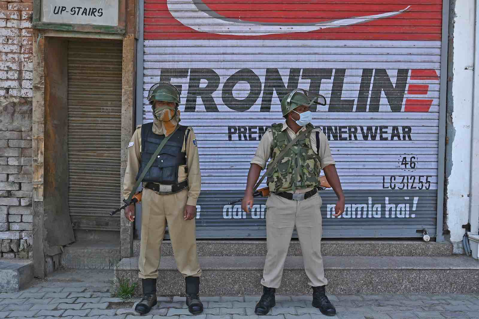 Indian paramilitary soldiers stand guard in central Srinagar, 10 June 2020 (Tauseef Mustafa/AFP via Getty Images)