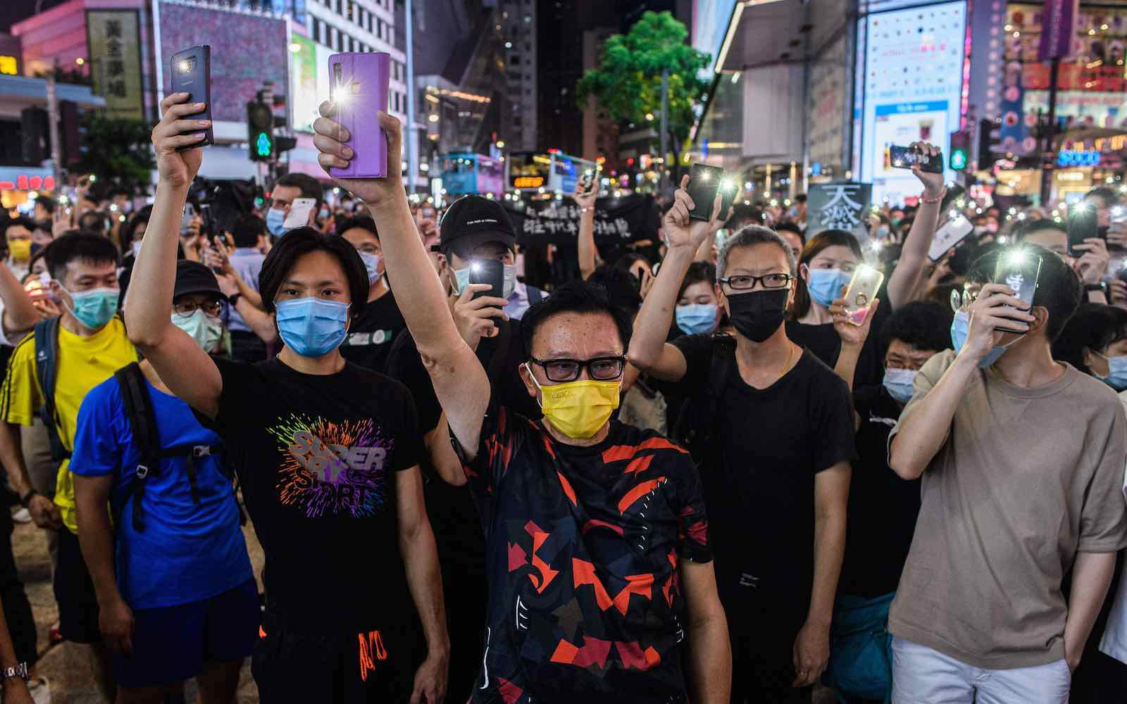 Pro-democracy activists at a rally in the Causeway Bay district of Hong Kong, 12 June 2020 (Anthony Wallace/AFP via Getty Images)
