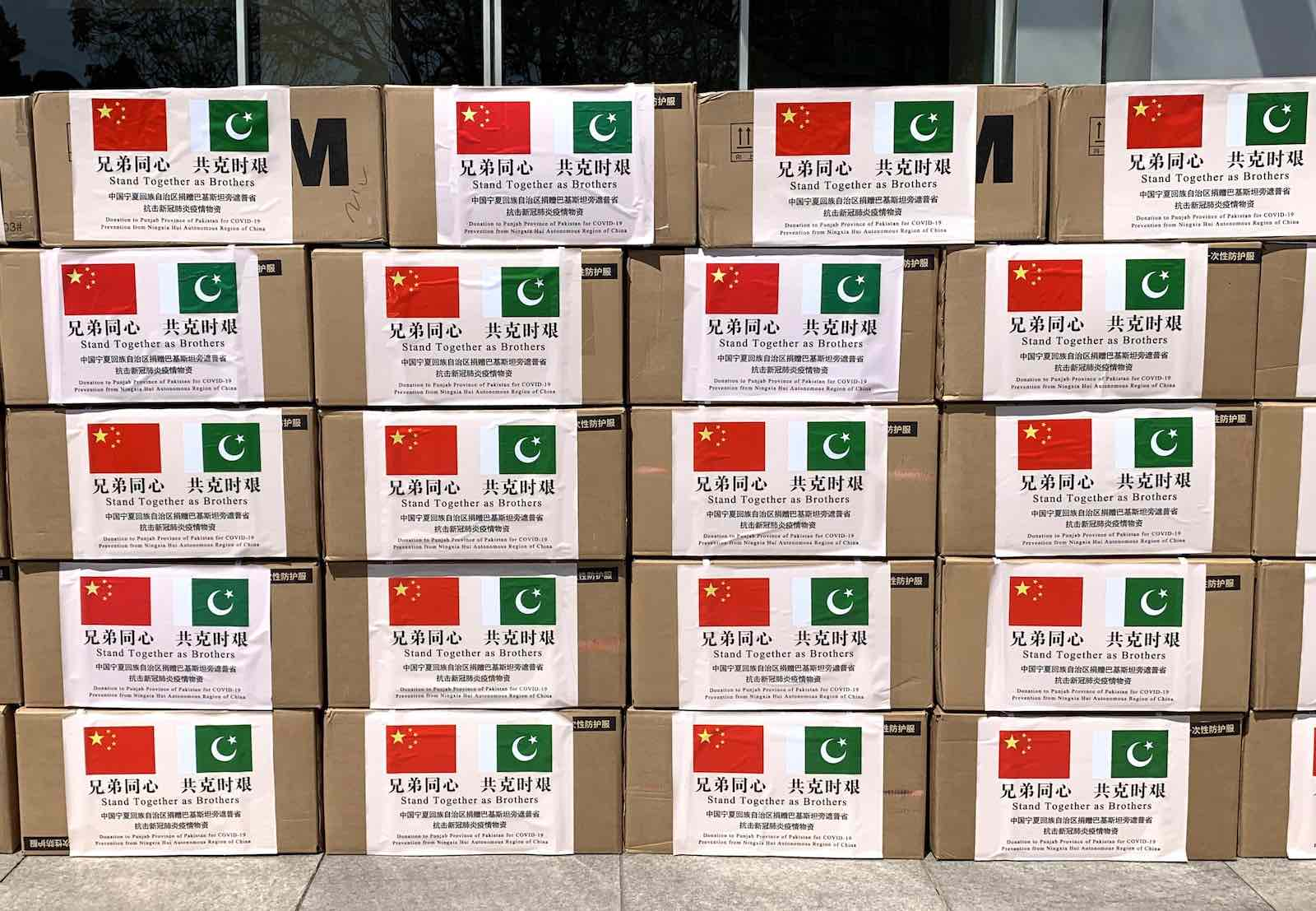 Boxes of medical supplies to be donated to Pakistan for anti-epidemic work, 24 April 2020 in Yinchuan, Ningxia Hui Autonomous Region of China (Li Peishan/China News Service via Getty Images)