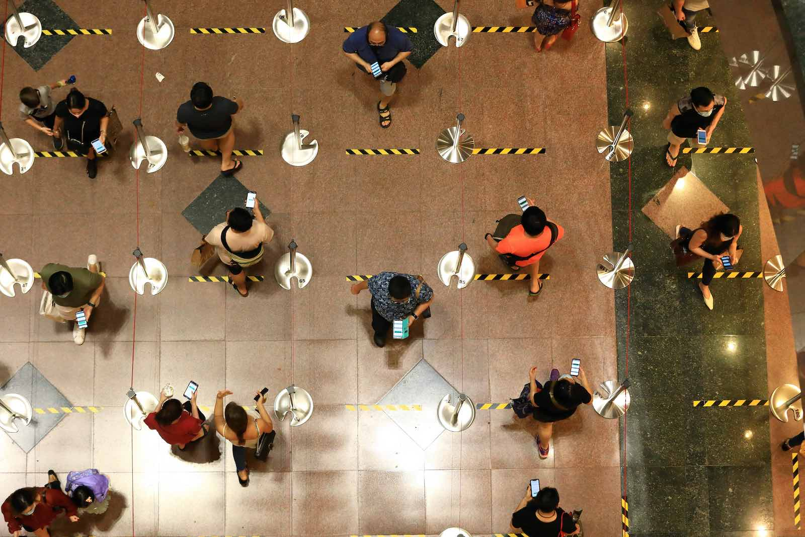 People queue to enter a shopping mall at Orchard Road in Singapore, June 2020 (Suhaimi Abdullah/Getty Images)