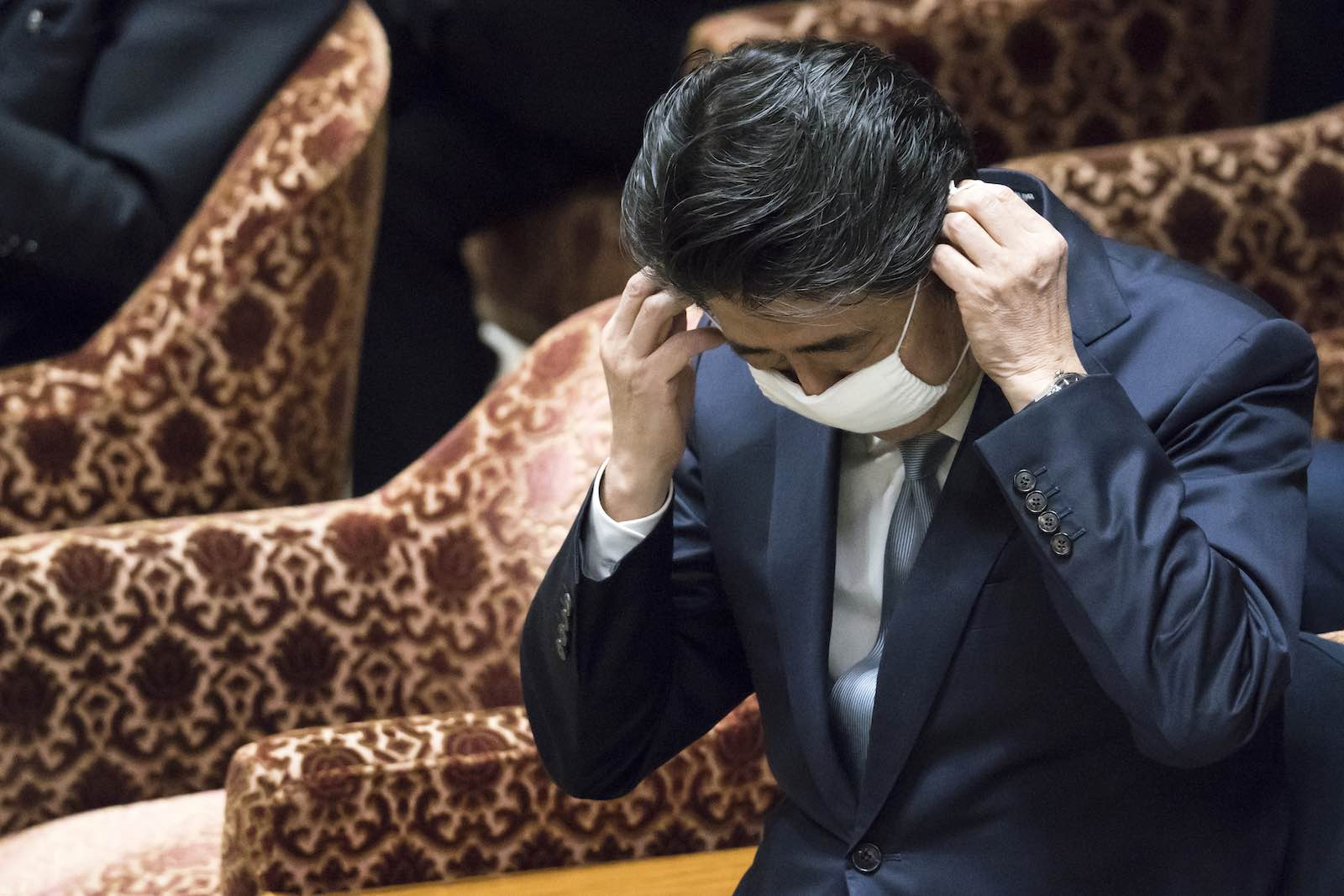 Japan's Prime Minister Abe Shinzo during a budget committee meeting at the lower house of parliament on 28 April (Tomohiro Ohsumi/Getty Images)