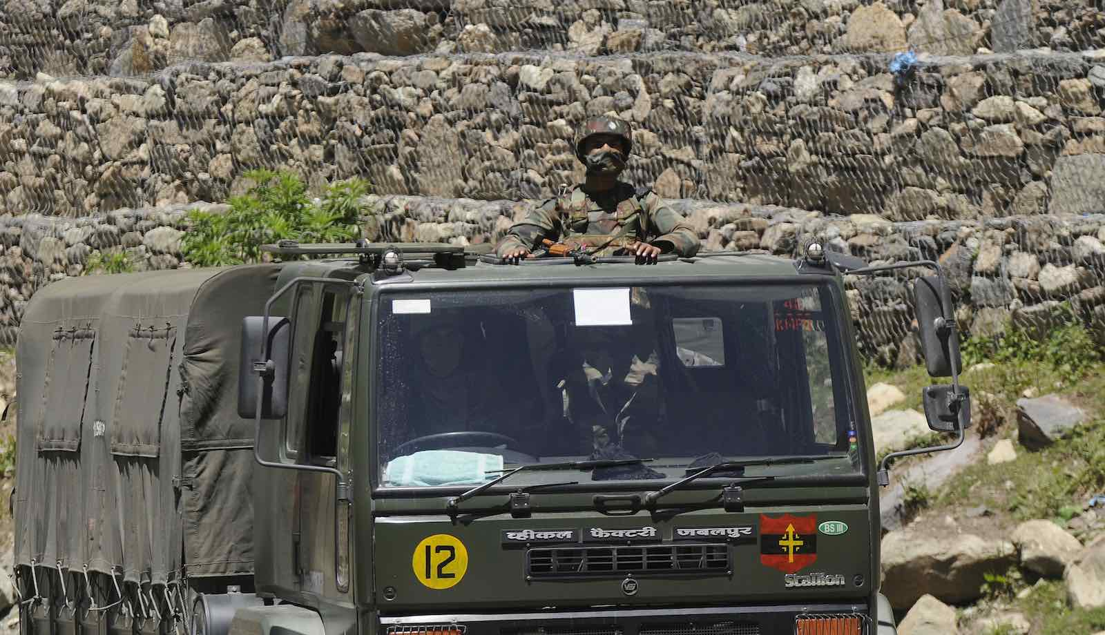 An Indian Army soldier looks out from a truck in a convoy to Ladakh, 22 June  2020 in Ganderbal, India (Waseem Andrabi/Hindustan Times via Getty Images)