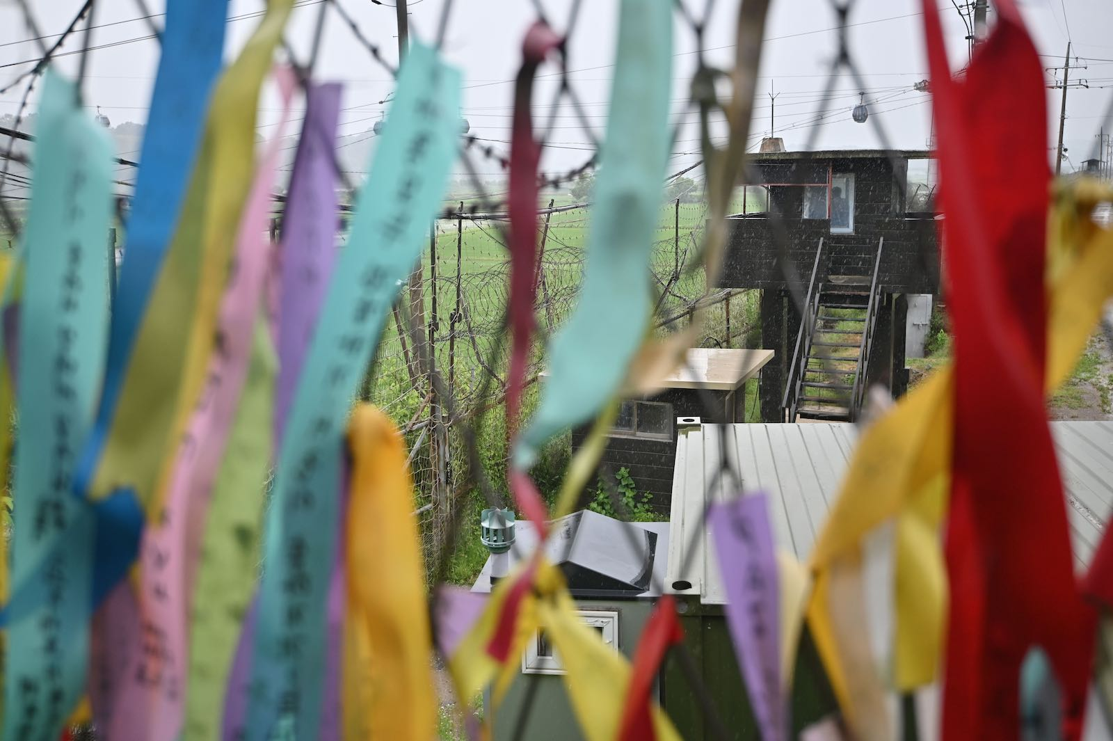 A South Korean guard post seen through a fence decorated with ribbons with messages of peace and reunification, at Imjingak peace park in the border city of Paju, June 2020 (Jung Yeon-je/AFP via Getty Images)