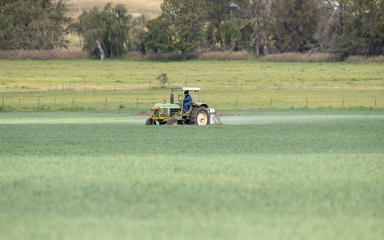 A farmer sprays his crop in Dungowan, north-west New South Wales, Australia, May 2020 (Mark Kolbe/Getty Images)