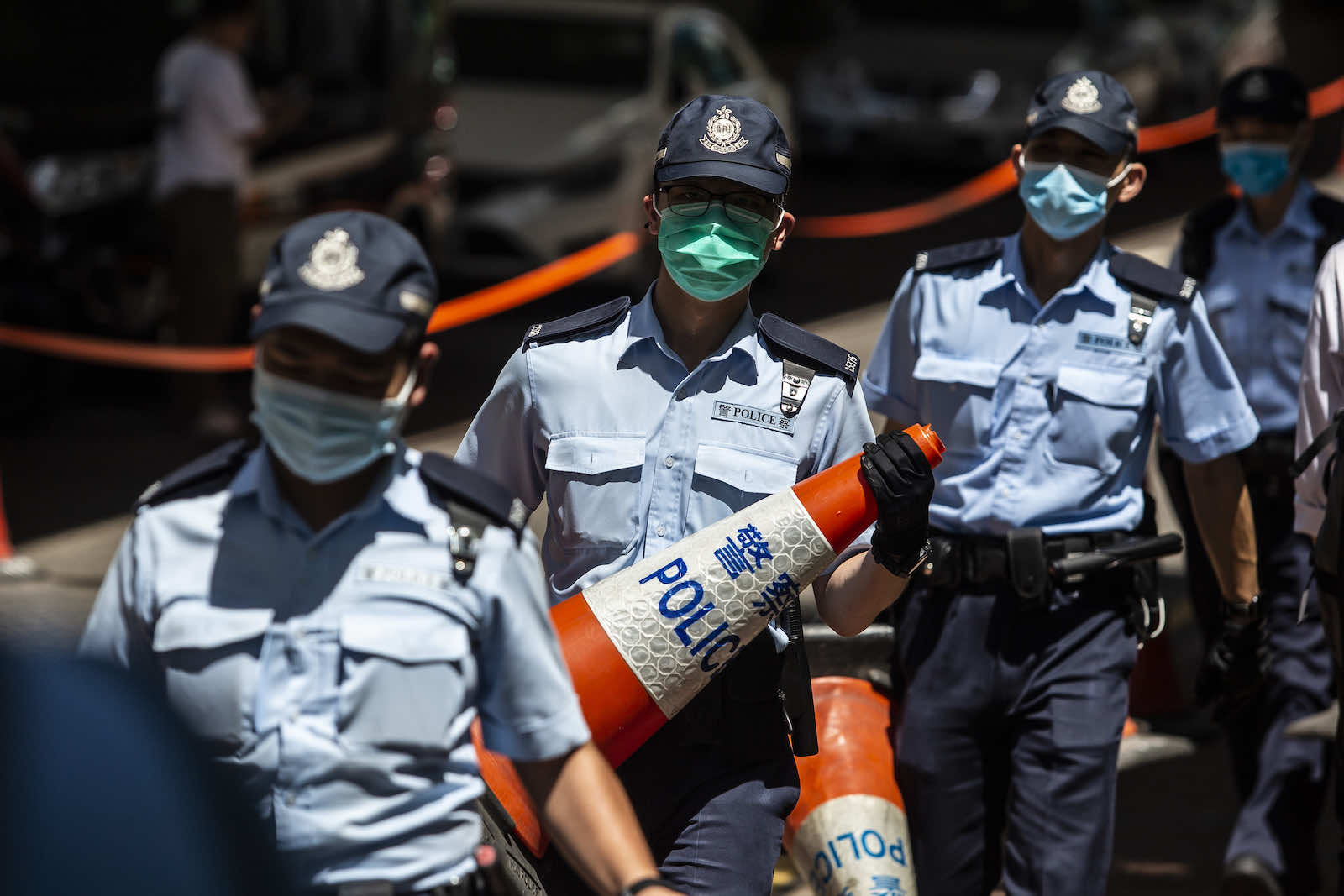 Police set up a cordon outside West Kowloon court in Hong Kong on 6 July (Isaac Lawrence/AFP via Getty Images)