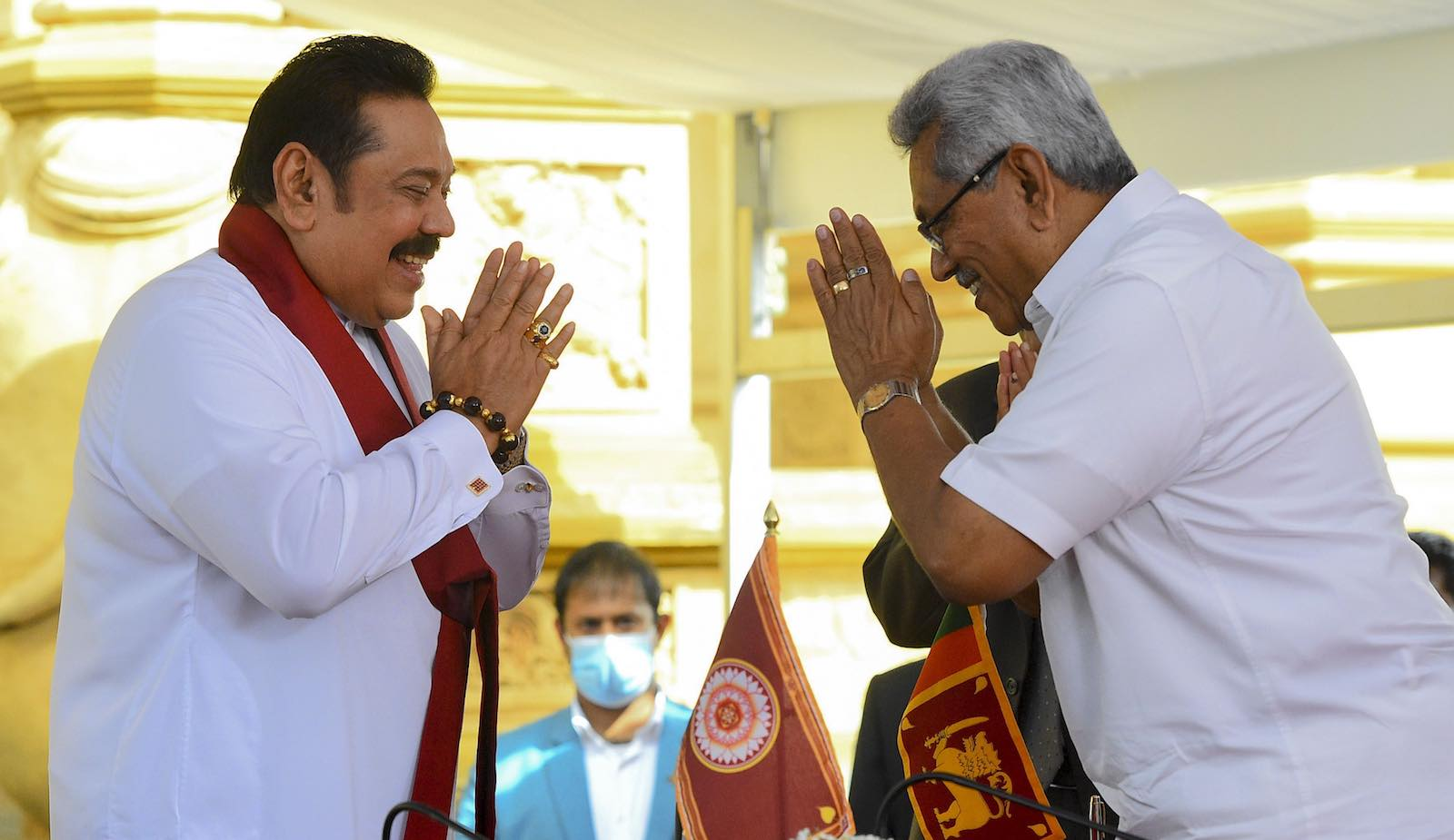 Sri Lanka's President Gotabaya Rajapaksa (right) swears in his brother and former president Mahinda Rajapaksa as Sri Lanka's new Prime Minister (Ishara S. Kodikara/AFP via Getty Images)