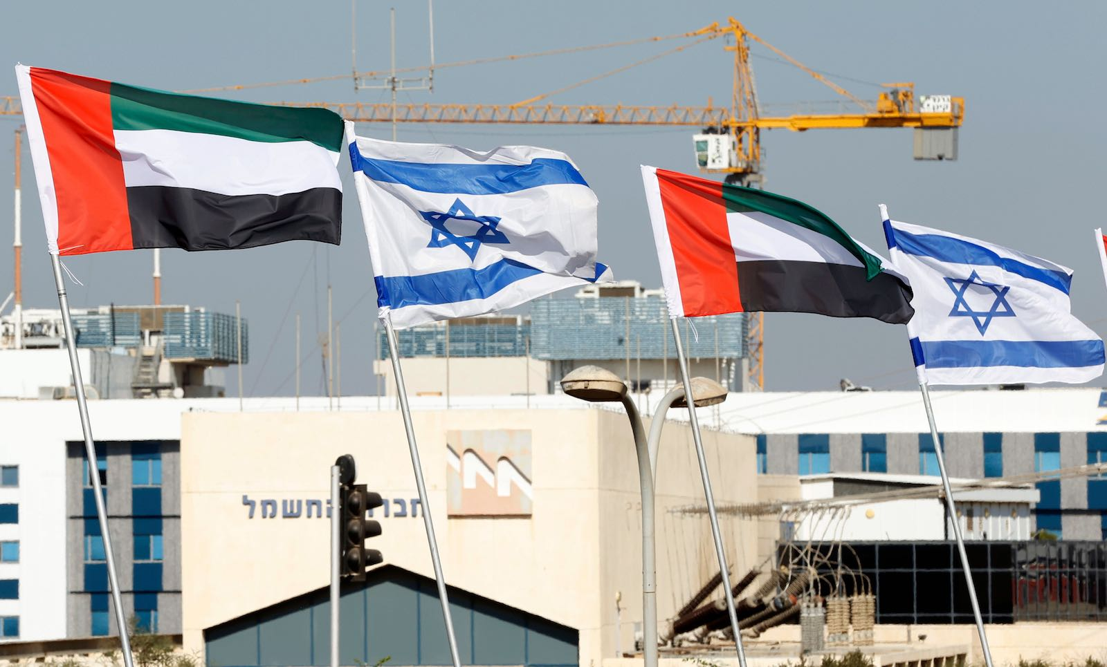 Israeli and United Arab Emirates flags line a road in the Israeli city of Netanya, 16 August 2020 (Jack Guez/AFP via Getty Images)