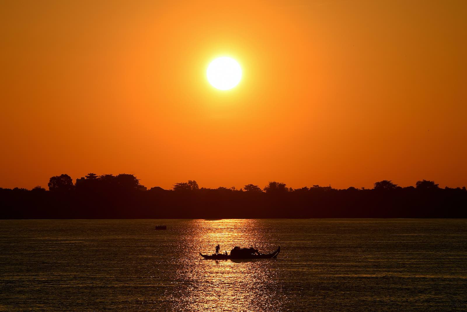 Fishing the Mekong River at sunrise in Phnom Penh, 26 August 2020 (Tang Chhin Sothy/AFP via Getty Images)