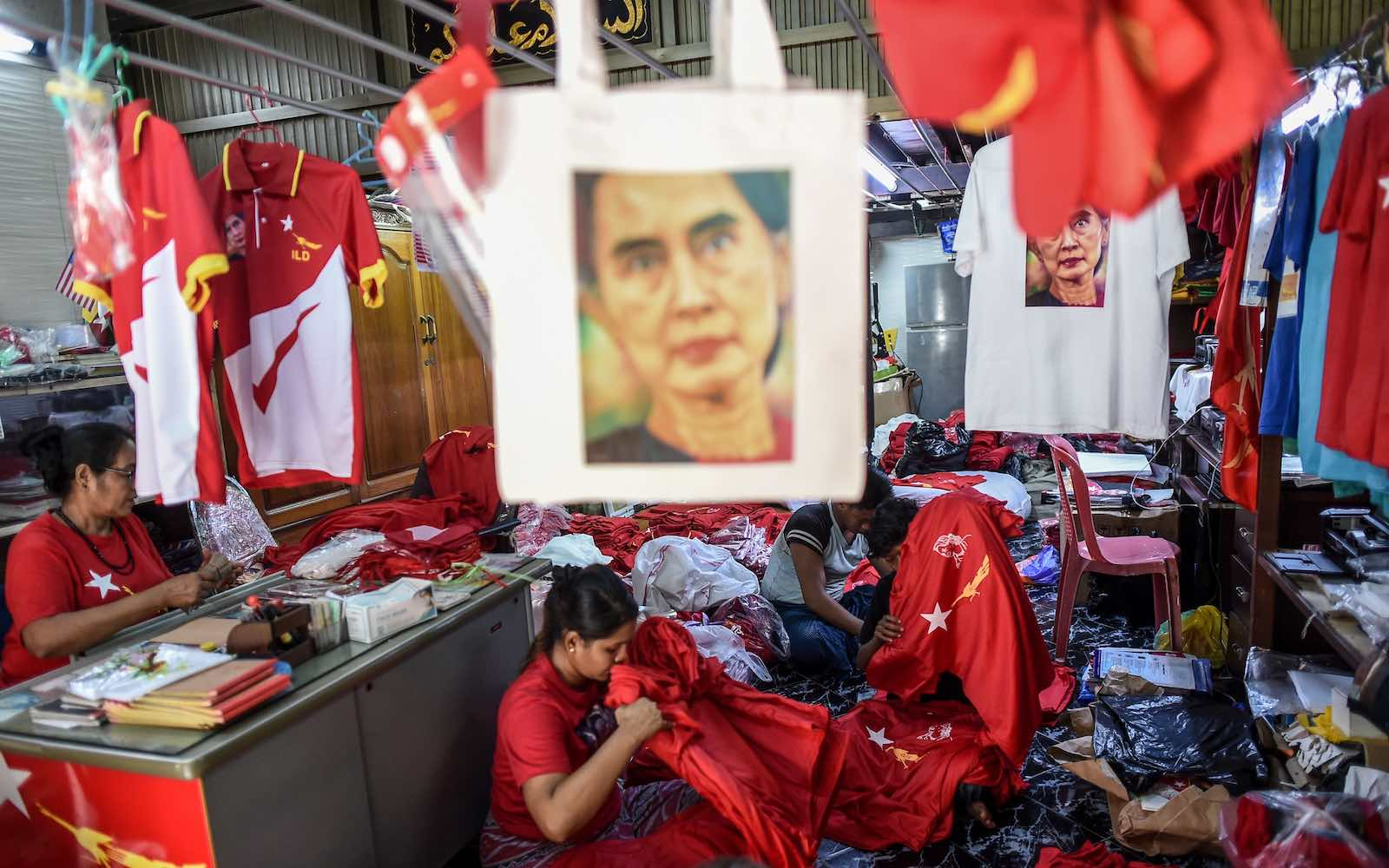 Workers pack T-shirts promoting Aung San Suu Kyi's National League for Democracy party at a print house in Yangon, 2 September 2020 (Ye Aung Thu/AFP via Getty Images)