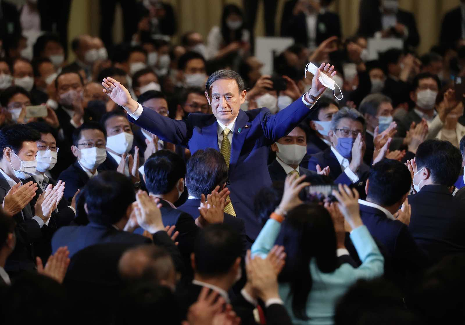 Japan's Chief Cabinet Secretary Yoshihide Suga reacts after he was elected as new head of Japan's ruling Liberal Democratic Party on Monday (AFP via Getty Images)