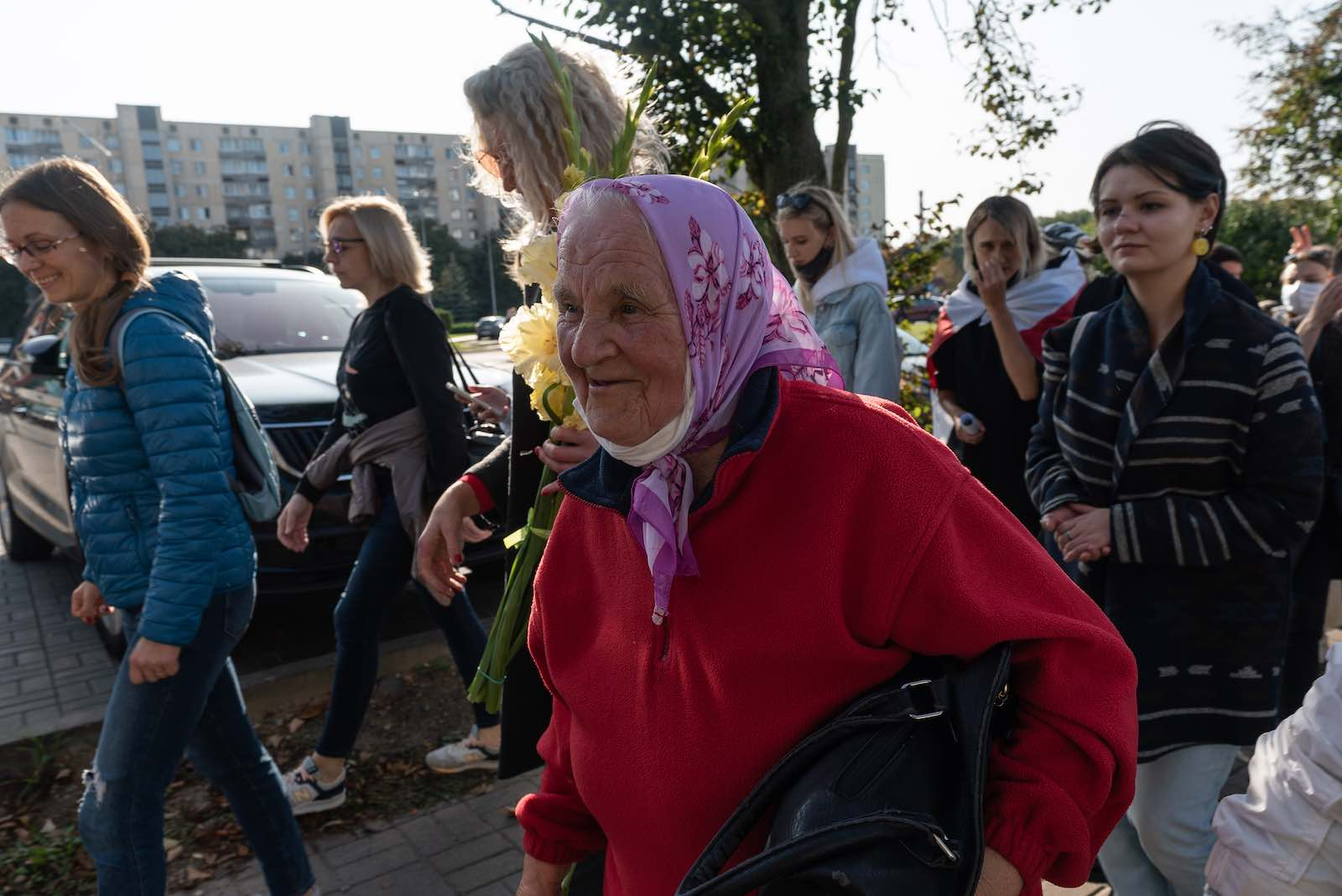 A elderly woman marches in a protest against the continued rule of president Alexander Lukashenko, 19 September 2020 in Minsk, Belarus (Jonny Pickup/Getty Images)