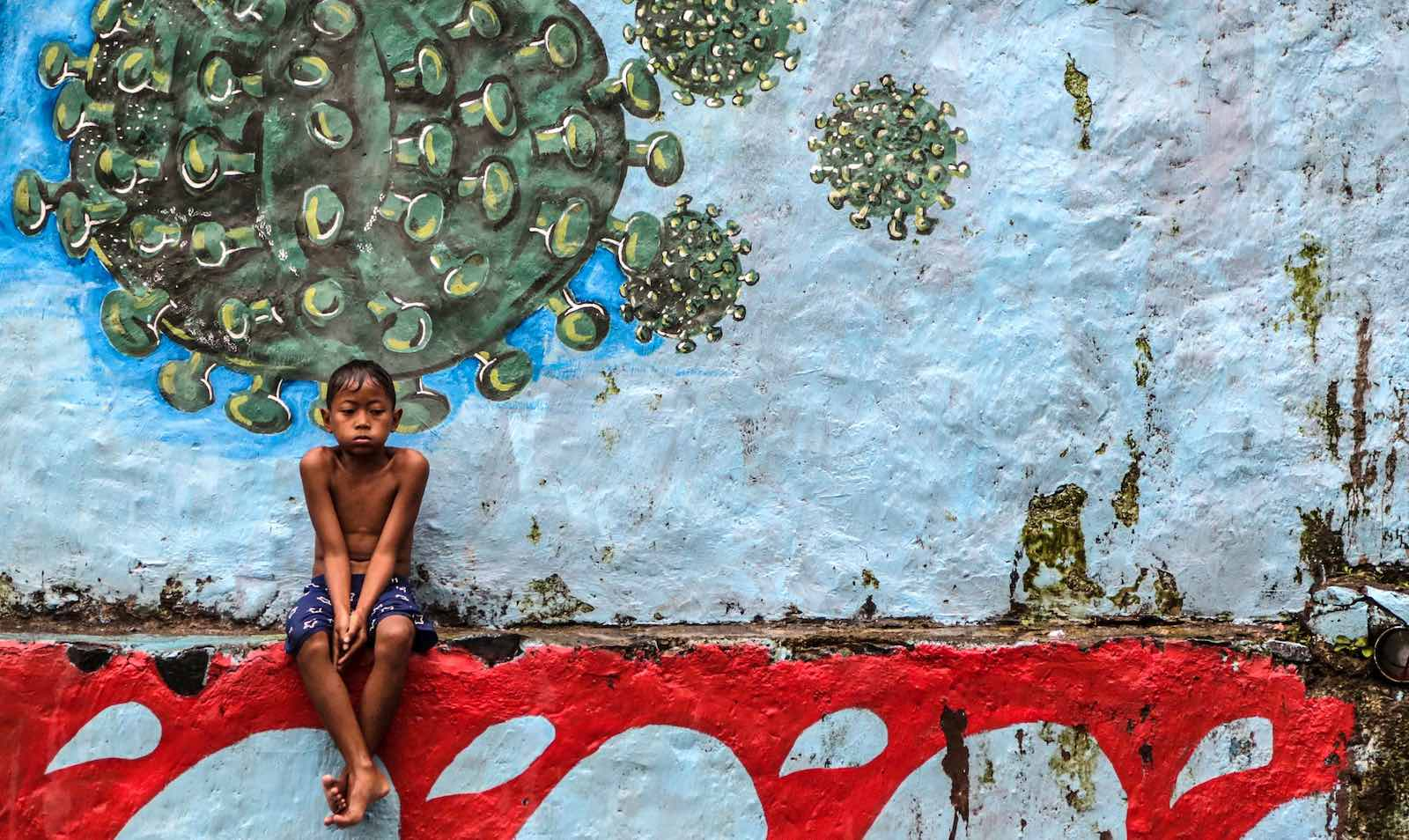 Bogor, West Java. It is reported the Covid-related mortality rate among Indonesian children has been 45 times higher than that of United States (Aditya Aji/AFP via Getty Images)