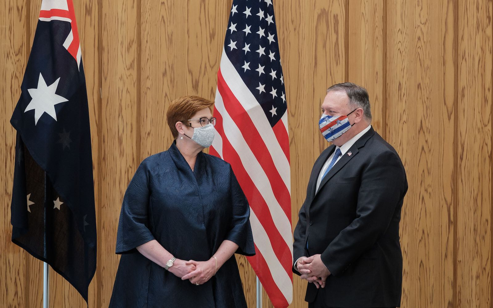 Foreign Minister Marise Payne (L) speaks with US Secretary of State Mike Pompeo during a Quad Indo-Pacific meeting in Tokyo, 6 October 2020 (Nicolas Datiche/Pool/AFP via Getty Images)