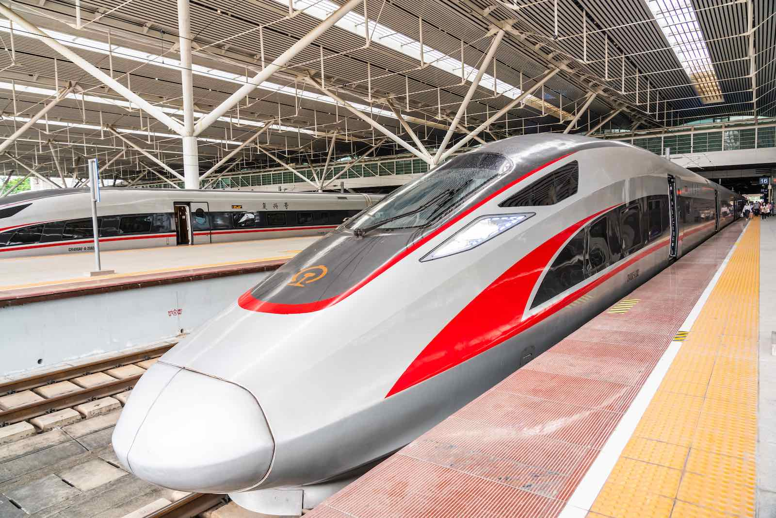 Fuxing high-speed trains operated by China Railway Corporation at Shenzhen North Railway Station in Guangdong province, 7 October (Alex Tai/SOPA Images/LightRocket via Getty Images)