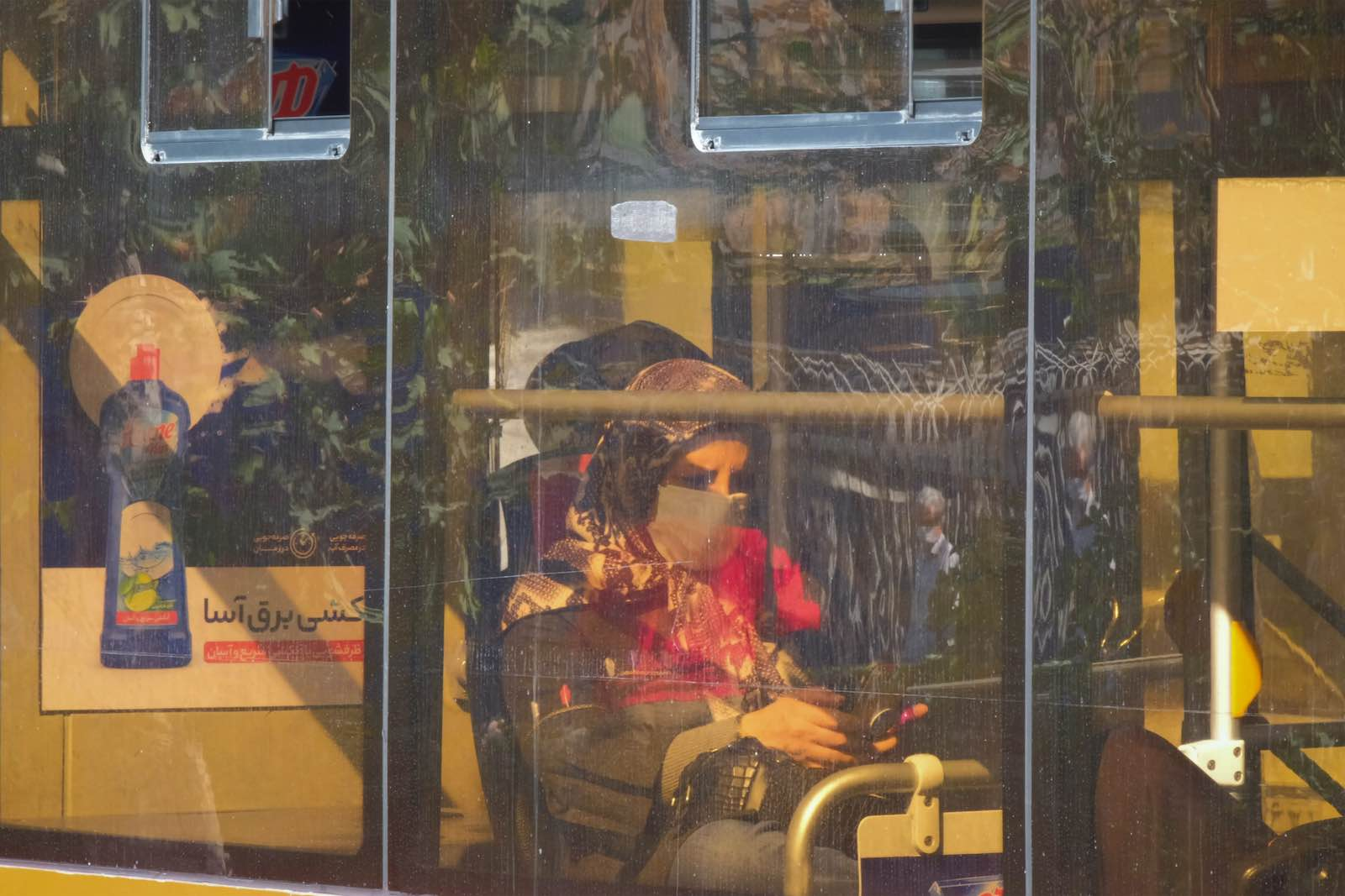 A woman on a bus in Tehran, October 2020 (Morteza Nikoubazl/NurPhoto via Getty Images)