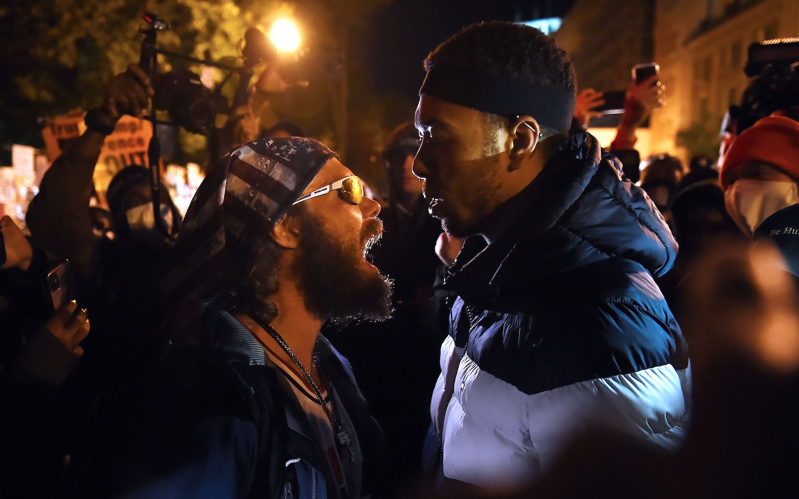 A Trump supporter (left) clashes with a demonstrator at Black Lives Matter plaza, across from the White House in Washington, DC, on 3 November 2020 (Olivier Douliery/AFP via Getty Images)