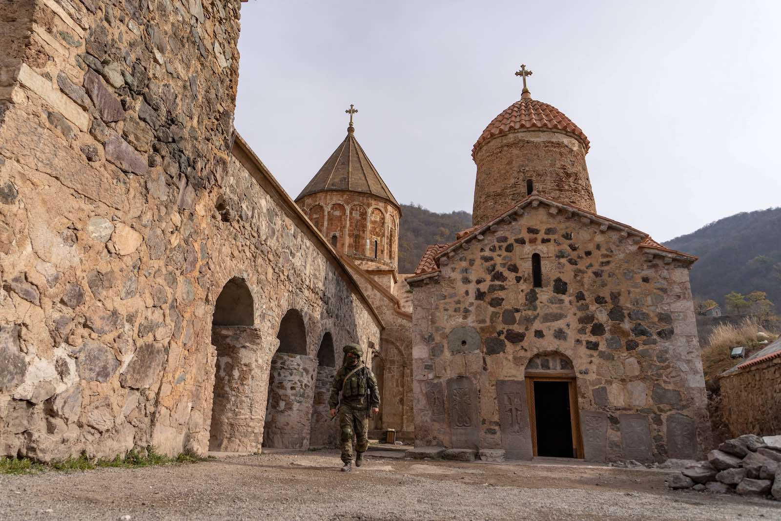 A Russian peacekeeper walks past the 12th–13th century Orthodox Dadivank Monastery, outside the town of Kalbajar on 16 November (Andrey Borodulin/AFP via Getty Images)