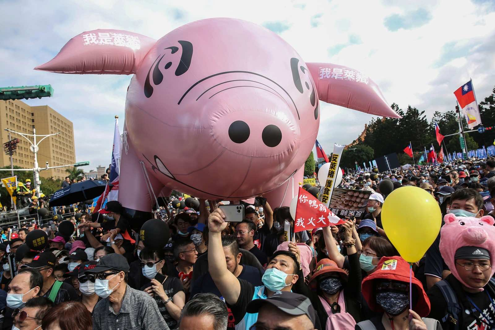 """Marchers at the annual pro-labour """"Autumn Struggle"""" protest against the lifting of restrictions on US pork containing ractopamine feed additive, Taipei, November 2020 (Hsu Tsun-hsu/AFP via Getty)"""