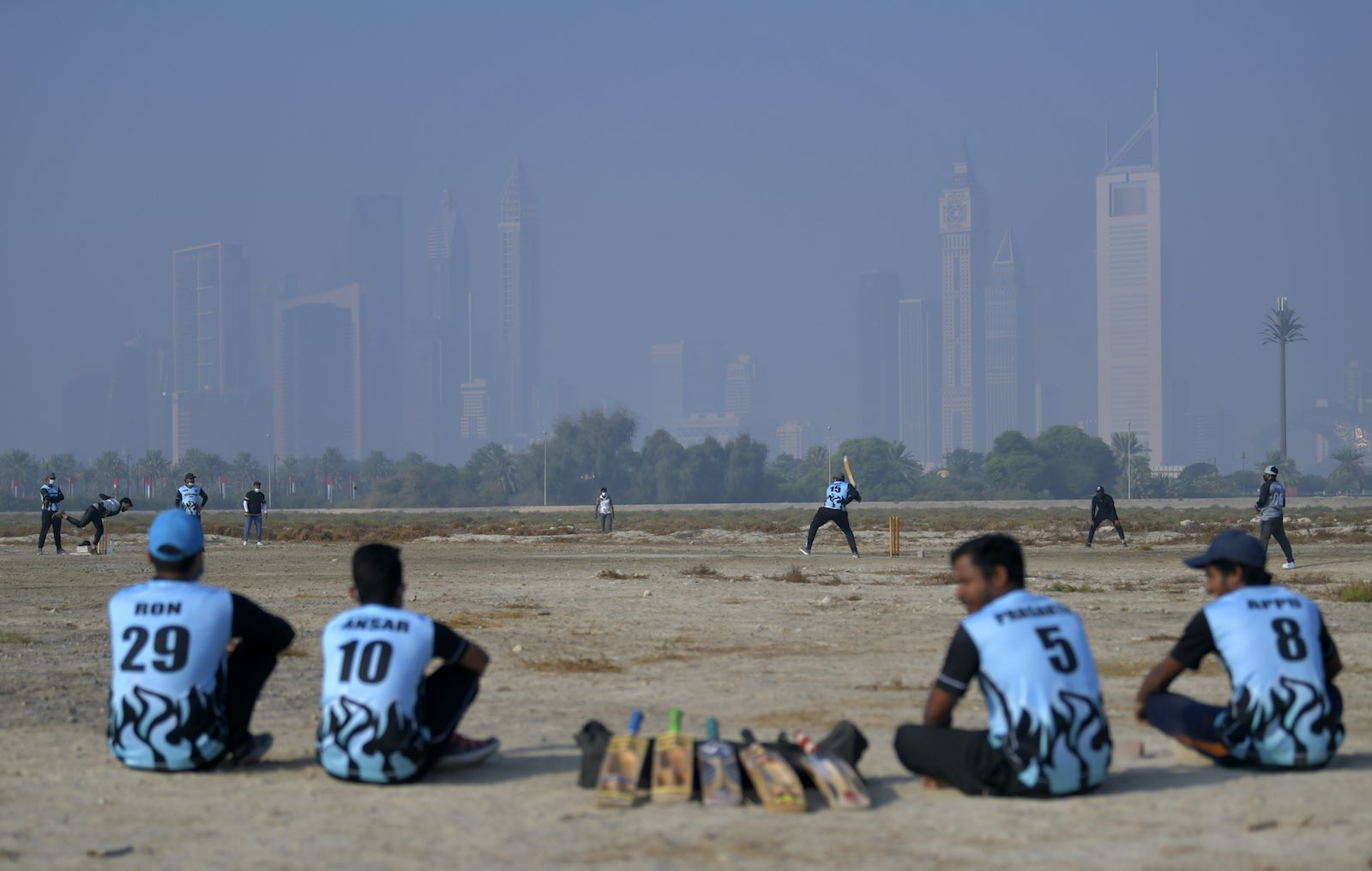 Workers in Dubai play cricket on their day off, 4 December 2020 (Karim SAHIB/AFP via Getty Images)