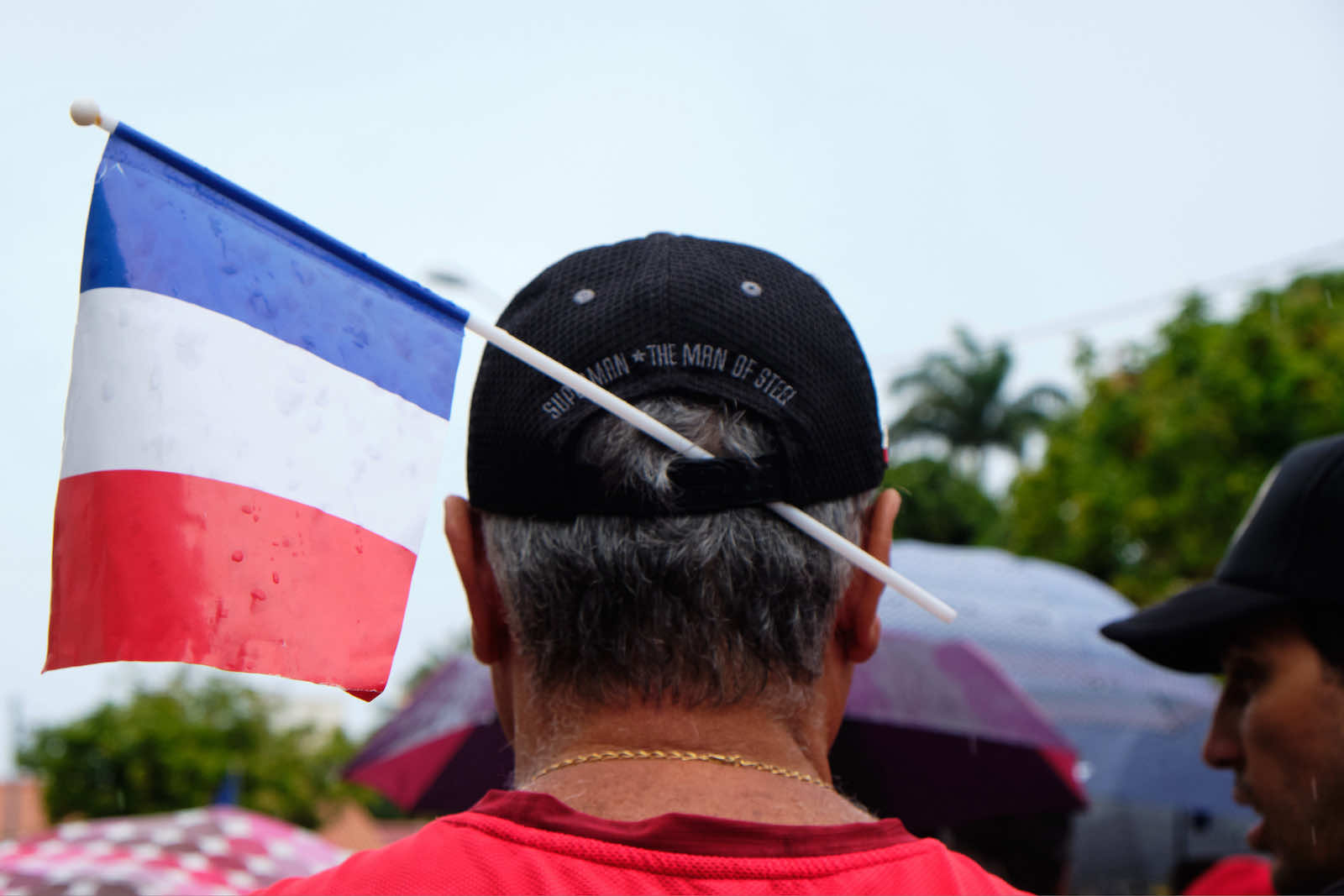 """A man wears a French flag in his cap during the """"March for Freedom"""" demonstration called by pro-France parties in Noumea in December 2020 (Getty Images)"""