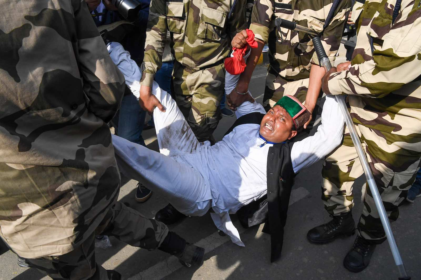 Police detained Indian Youth Congress workers during a protest against new agricultural laws, unemployment and rising prices, New Delhi, 9 February (Prakash Singh/AFP via Getty Images)