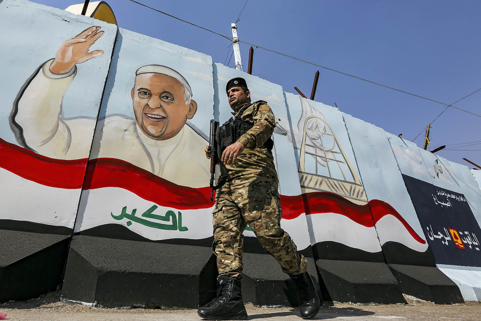 A mural depicting Pope Francis drawn on a blast wall outside the Syriac Catholic Church of Our Lady of Deliverance in the Karrada district of Iraq's capital Baghdad, 1 March (Sabah Arar/AFP via Getty Images)