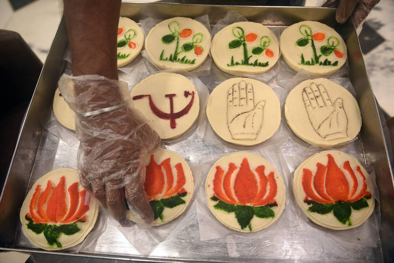 Sweets with political party symbols ahead of West Bengal Assembly election (Samir Jana/Hindustan Times via Getty Images)