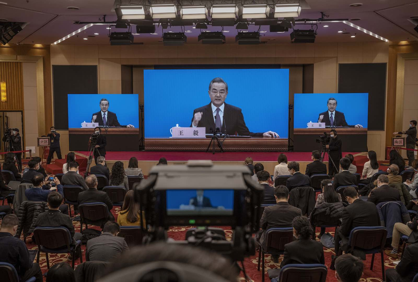 China's Foreign Minister Wang Yi speaks during a video news conference as part of the National People's Congress, 7 March in Beijing (Kevin Frayer/Getty Images)