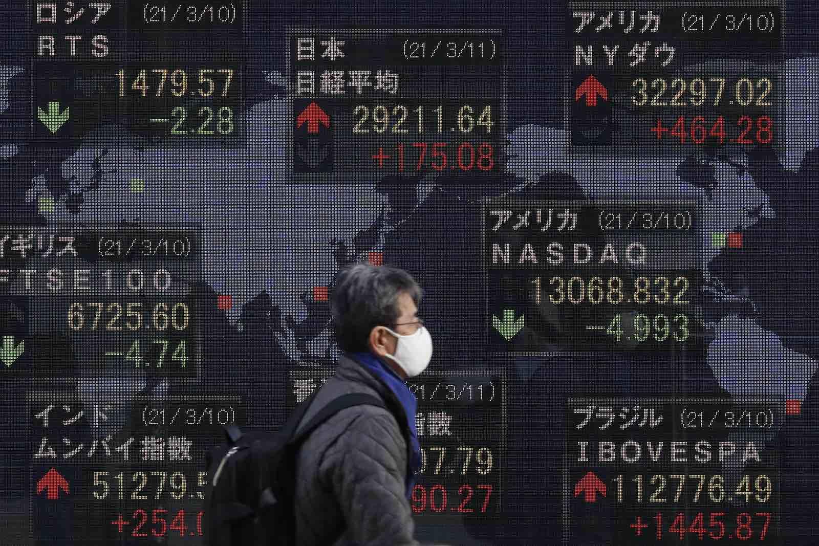 Global stock exchange updates on display in Tokyo, 11 March 2021 (James Matsumoto/SOPA Images/LightRocket via Getty Images)