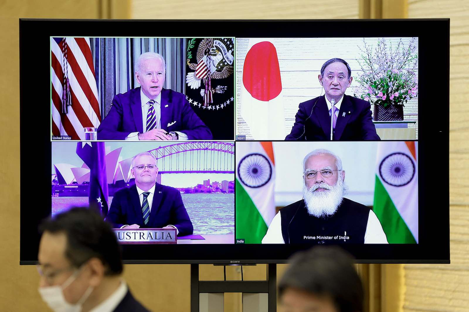 A monitor displays the leaders of the US, Japan, India and Australia during a virtual Quadrilateral Security Dialogue meeting, 12 March in Tokyo (Kiyoshi Ota/Pool/AFP via Getty Images)