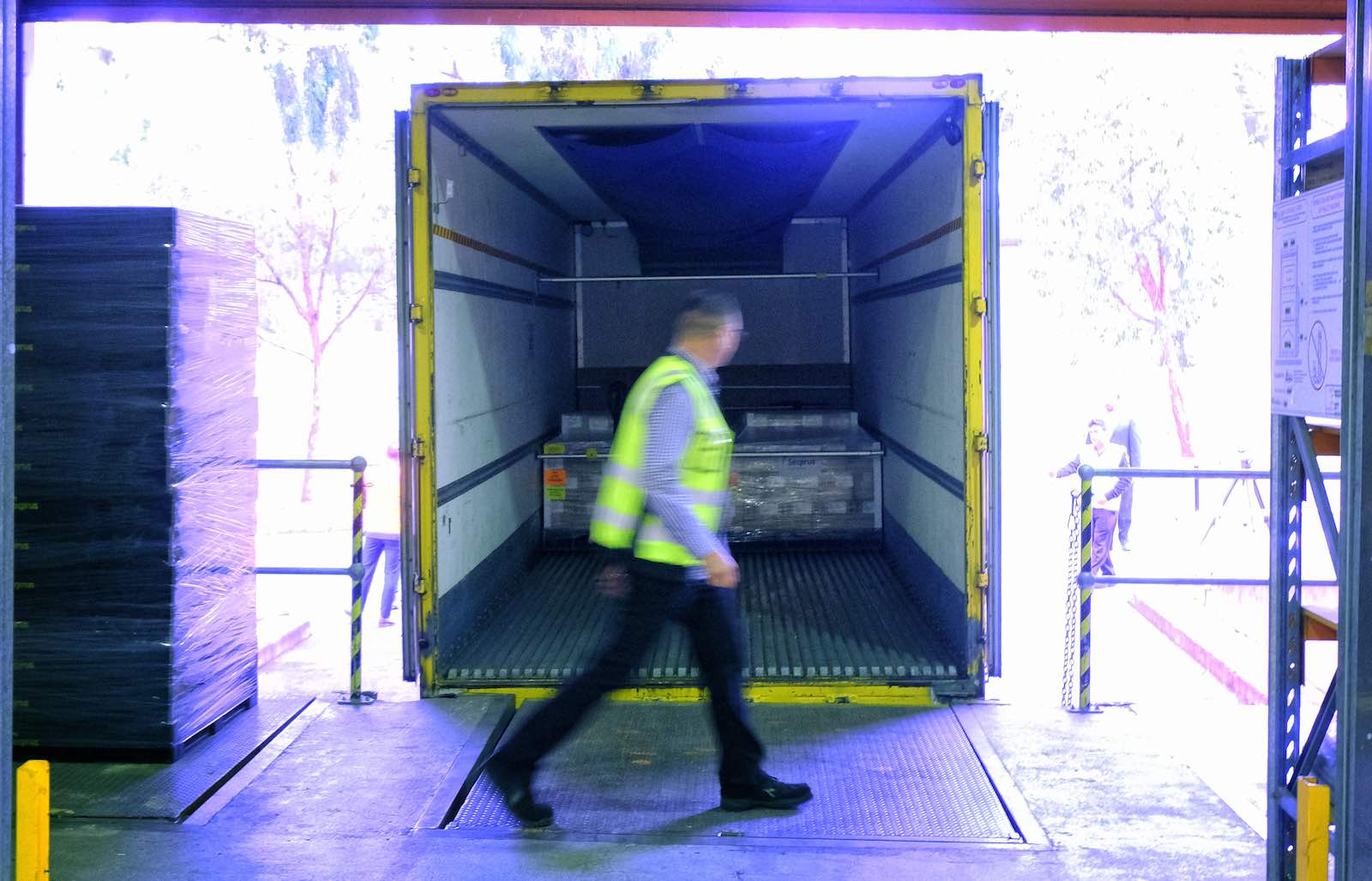 Workers at CSL loading the first batch of Australian-produced AstraZeneca Covid-19 vaccine for distribution, Melbourne, 24 March 2021 (Luis Ascui/Getty Images)