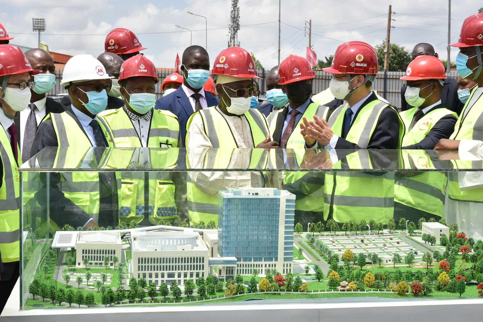 Cameroonian officials and the Chinese Ambassador to Cameroon visit the site of the country's new National Assembly building, a China-aided project under construction in Yaounde, Cameroon, 23 March 2021 (Jean Pierre Kepseu/Xinhua via Getty Images)