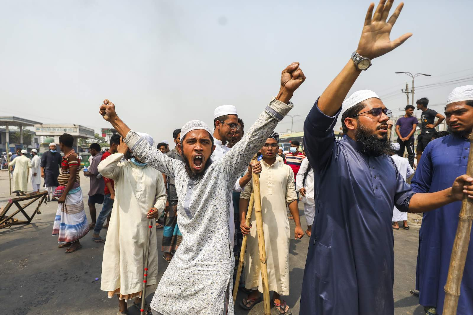 Activists from Hefazat-e-Islam block a road following deadly clashes with police over Indian Prime Minister Narendra Modi's visit, 28 March 2021 in Narayanganj, Bangladesh (Ahmed Salahuddin/NurPhoto via Getty Images)