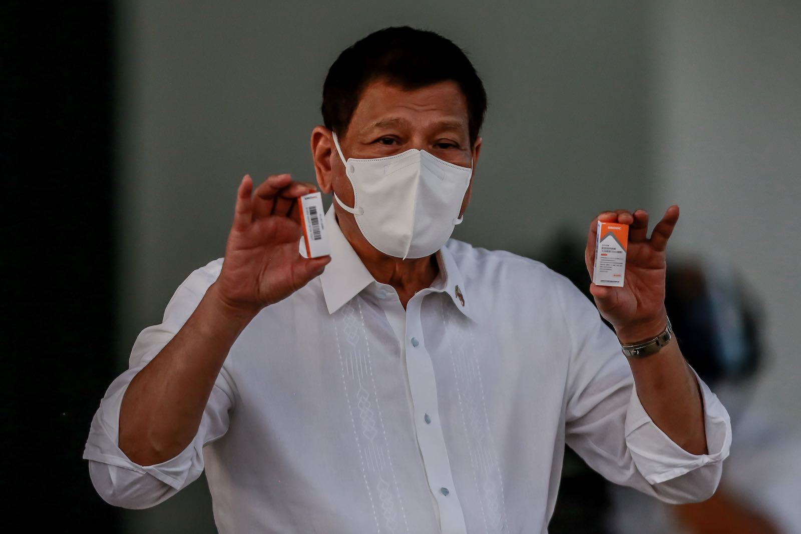 Philippine President Rodrigo Duterte shows boxes of newly arrived Sinovac Covid-19 vaccines purchased from China, 29 March 2021 in Manila (Xinhua/Rouelle Umali via Getty Images)